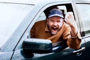 Road rage rules with this infuriated driver shaking his fist